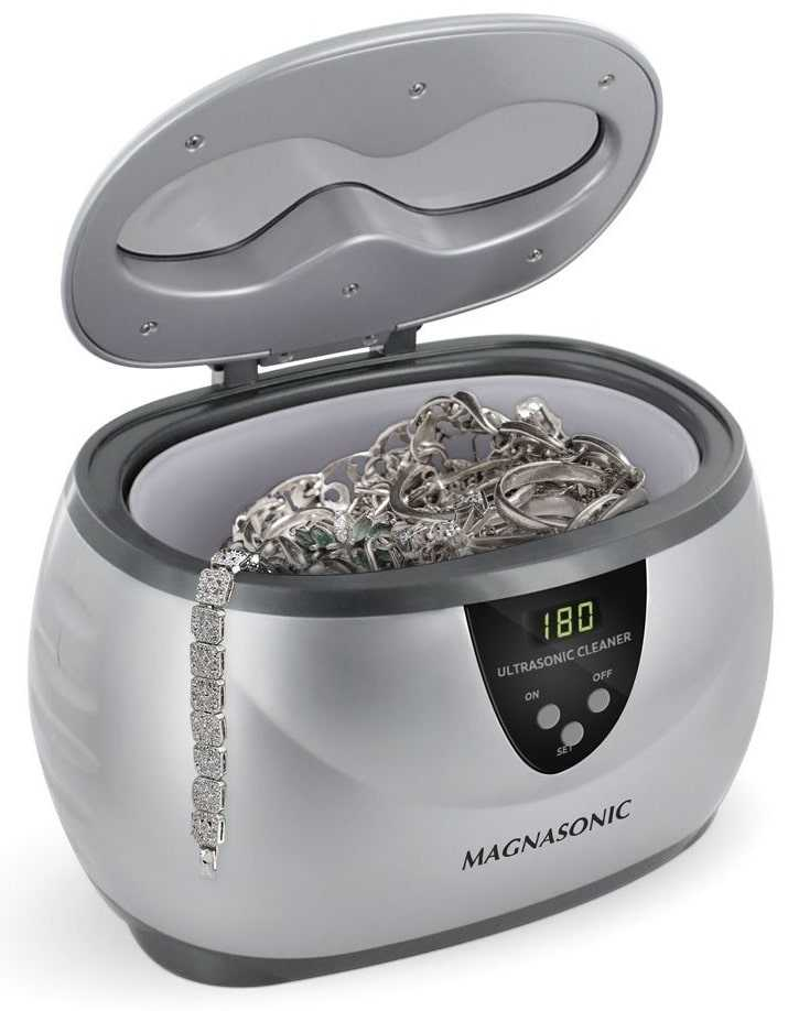 An electronic ultrasonic jewelry cleaner