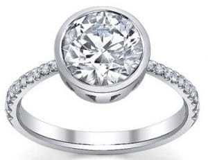 Round stone on bezel set diamond rings