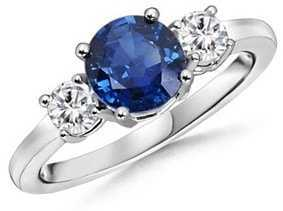 Round shaped diamond and sapphire ring