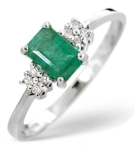 diamond and emerald ring with side stones