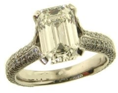 emerald cut diamond engagement ring with pave stones