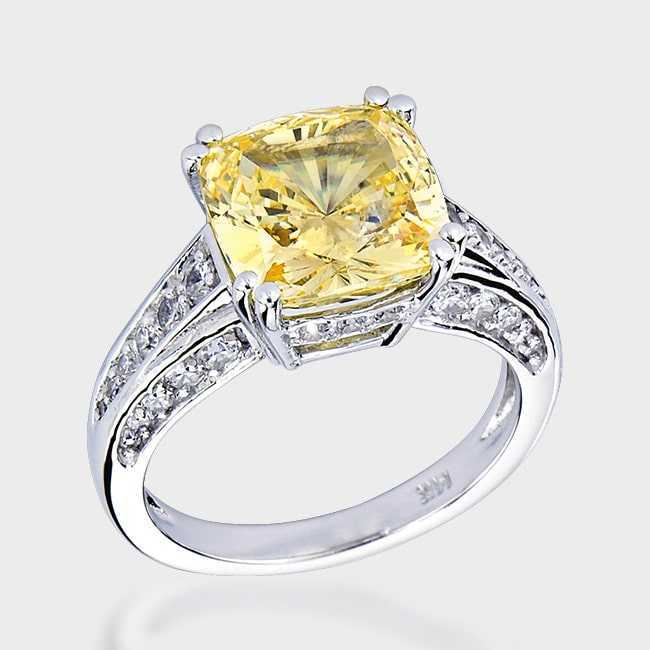 fake diamond ring with yellow center stone