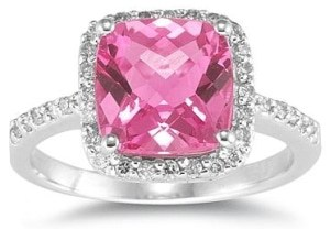 A pink diamond engagement ring with accent stones