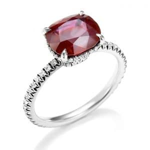 Solitaire ruby and diamond ring with side stones