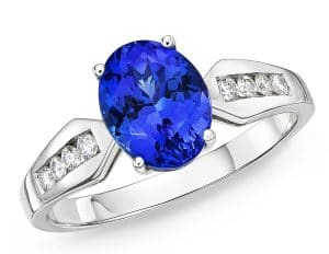 Tension set tanzanite and diamond ring with side stones