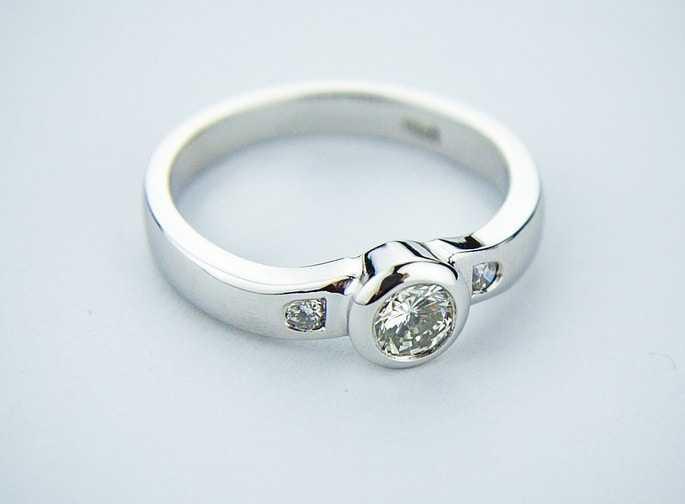 Bezel set white gold diamond engagement ring